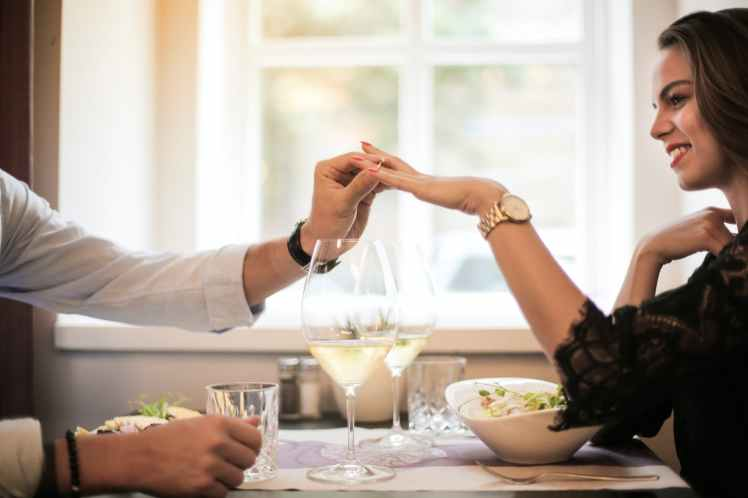 crop man making proposal in luxurious restaurant during dinner